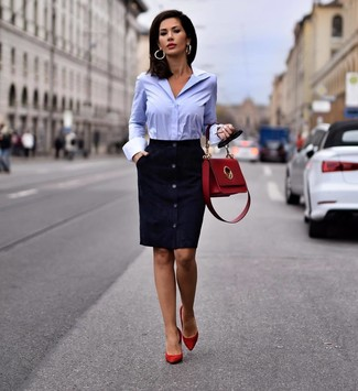 How to wear: red leather satchel bag, red suede pumps, light blue dress shirt, navy suede sheath dress