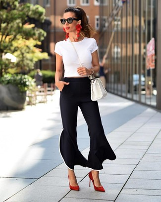 How to wear: white leather crossbody bag, red suede pumps, black flare pants, white crew-neck t-shirt