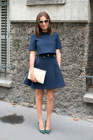 How to wear: beige leather clutch, green suede pumps, navy full skirt, navy cropped top