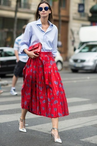 How to Wear a Light Blue Dress Shirt For Women: Pair a light blue dress shirt with a red print full skirt if you want to look casually edgy without much work. Look at how great this look is rounded off with a pair of silver leather pumps.