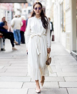 How to Wear Beige Leather Pumps: Showcase that no-one does semi-casual quite like you do by opting for a white silk button down blouse and a white silk midi skirt. A pair of beige leather pumps is a smart option to complement your outfit.