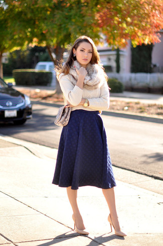 How to wear: brown snake leather crossbody bag, tan leather pumps, navy pleated midi skirt, beige cable sweater