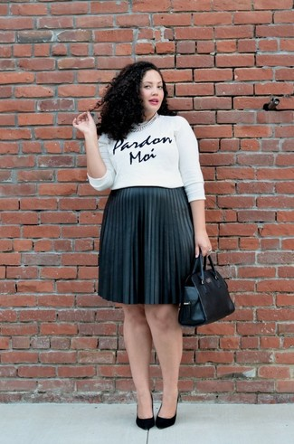 How to wear: black leather tote bag, black suede pumps, black pleated midi skirt, white and black print crew-neck sweater