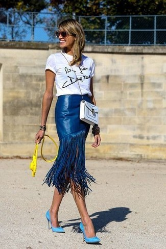 Which Midi Skirt To Wear With a White and Black Crew-neck T-shirt: A white and black crew-neck t-shirt and a midi skirt work together harmoniously. On the shoe front, go for something on the smarter end of the spectrum by rocking a pair of aquamarine suede pumps.