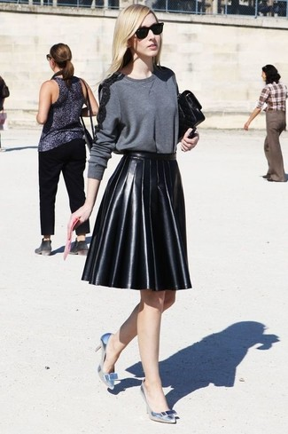 How to wear: black leather clutch, silver leather pumps, black pleated leather mini skirt, charcoal crew-neck sweater