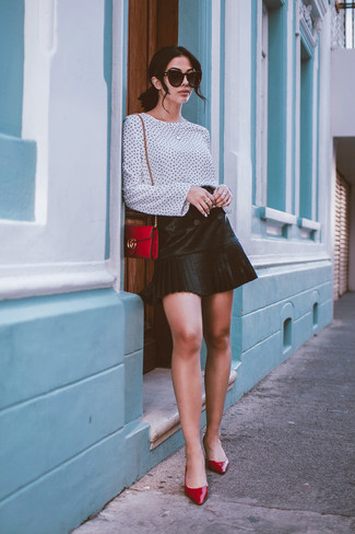 How to wear: red leather crossbody bag, red leather pumps, black pleated leather mini skirt, white and black polka dot long sleeve blouse