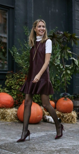 How to Wear a White Short Sleeve Sweater For Women: Consider teaming a white short sleeve sweater with a burgundy leather overall dress to get a casual and functional ensemble. If you feel like playing it up a bit, introduce a pair of burgundy velvet pumps to this look.