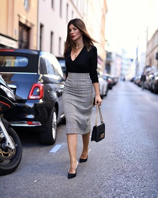How to wear: black leather satchel bag, black satin pumps, white and black houndstooth pencil skirt, black v-neck sweater