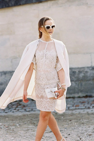 How to Wear a Silver Leather Clutch: If you're looking for a casual yet absolutely chic look, choose a white coat and a silver leather clutch. Infuse your outfit with a dose of elegance by wearing white leather pumps.