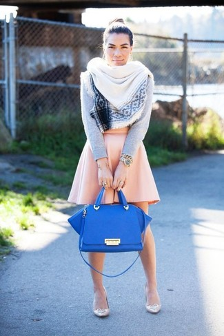 How to wear: blue leather satchel bag, beige leather pumps, pink skater skirt, grey crew-neck sweater