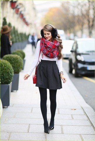 How to wear: red leather crossbody bag, black leather pumps, black polka dot skater skirt, white long sleeve t-shirt