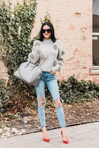 How to Wear Light Blue Ripped Skinny Jeans: This pairing of a grey crew-neck sweater and light blue ripped skinny jeans is outrageously chic and yet it's laid-back and apt for anything. Make your look a bit dressier by finishing with red suede pumps.