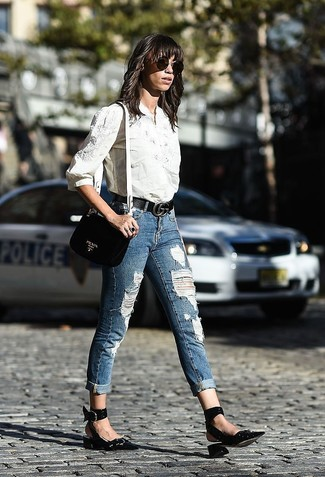 How to wear: black leather crossbody bag, black leather pumps, blue ripped skinny jeans, white embroidered dress shirt
