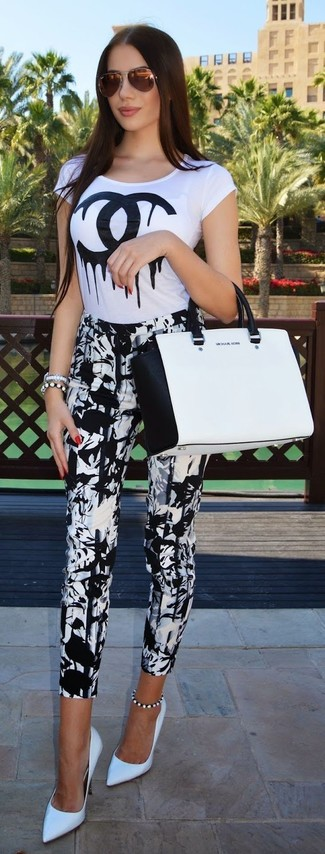 How to wear: white and black leather tote bag, white leather pumps, white and black print skinny pants, white and black print crew-neck t-shirt
