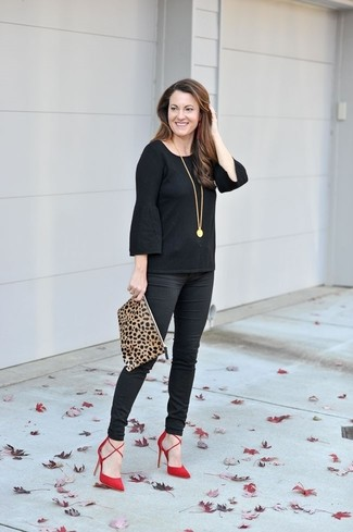 How to wear: tan leopard suede clutch, red suede pumps, black skinny pants, black ruffle long sleeve t-shirt