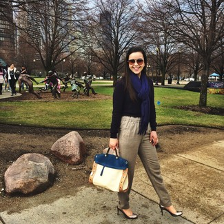 How to wear: white and blue leather satchel bag, silver leather pumps, beige tapered pants, navy crew-neck sweater