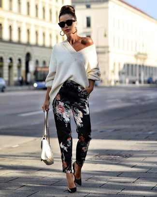 How to wear: white quilted leather satchel bag, black leather pumps, black floral tapered pants, white knit oversized sweater
