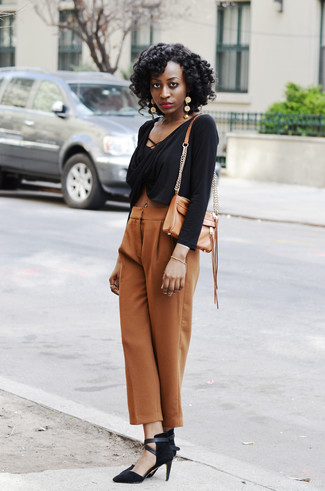 How to wear: tan leather crossbody bag, black suede pumps, tan wide leg pants, black cropped top