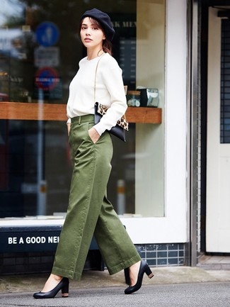 How to wear: black and tan leopard calf hair crossbody bag, black leather pumps, olive wide leg pants, white sweatshirt