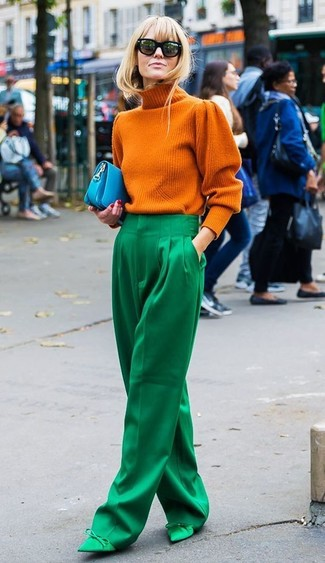How to wear: aquamarine leather clutch, green satin pumps, green wide leg pants, orange knit turtleneck