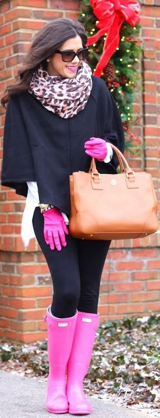 How to wear: tobacco leather tote bag, hot pink rain boots, black leggings, black cape coat