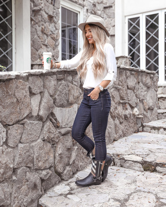 How to wear: grey wool hat, black plaid rain boots, navy skinny jeans, white long sleeve blouse