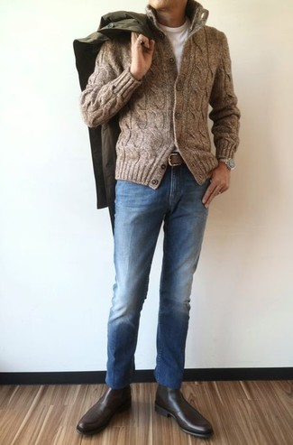 How to wear: olive raincoat, brown knit cardigan, white crew-neck t-shirt, blue jeans