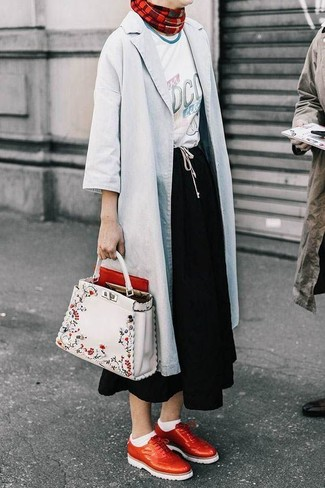 How to wear: grey raincoat, white print crew-neck t-shirt, black midi skirt, red leather brogues
