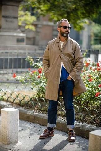 How to wear: tan raincoat, beige long sleeve shirt, blue crew-neck t-shirt, navy jeans