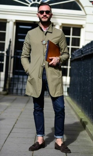 How to wear: olive raincoat, pink long sleeve shirt, navy jeans, dark brown suede tassel loafers