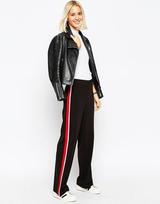How to wear: white and black low top sneakers, red and black wide leg pants, white short sleeve sweater, black leather biker jacket