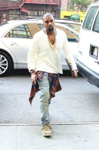 Kanye West wearing Red and Navy Plaid Long Sleeve Shirt, White Henley Shirt, Light Blue Jeans, Tan Suede Desert Boots