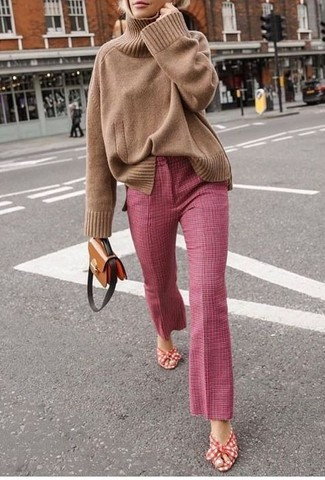 How to wear: brown leather crossbody bag, red and white canvas heeled sandals, pink flare pants, tan knit turtleneck