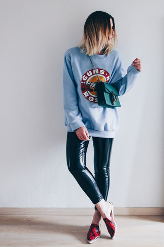 How to wear: teal leather crossbody bag, red print leather espadrilles, black leather leggings, light blue print sweatshirt