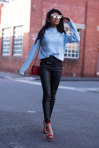 How to wear: red leather crossbody bag, red leather heeled sandals, black leather skinny pants, light blue turtleneck
