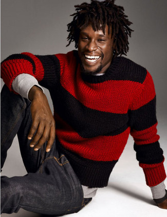 For an outfit that provides comfort and fashion, rock a red striped crew-neck sweater with navy blue jeans. Rest assured, this combination will keep you comfortable as well as looking stylish in this transitional weather.