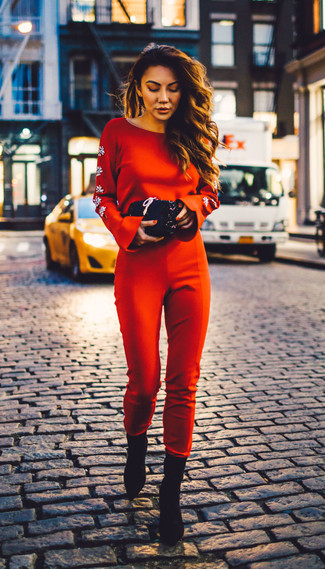 How to wear: red jumpsuit, black suede ankle boots, black sequin clutch