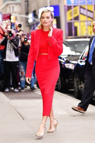 Women's Looks & Outfits: What To Wear In 2020: Why not pair a red blazer with a red midi skirt? As well as very practical, both of these pieces look incredible matched together. A pair of gold leather heeled sandals can integrate seamlessly within a myriad of ensembles.