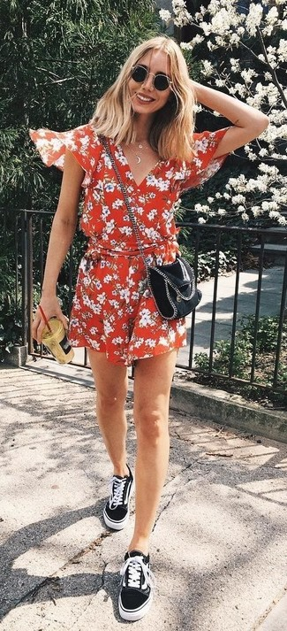 How to wear: red floral playsuit, black canvas low top sneakers, black leather crossbody bag, black sunglasses