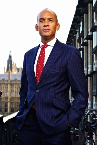 How to wear: red polka dot tie, white dress shirt, navy vertical striped suit
