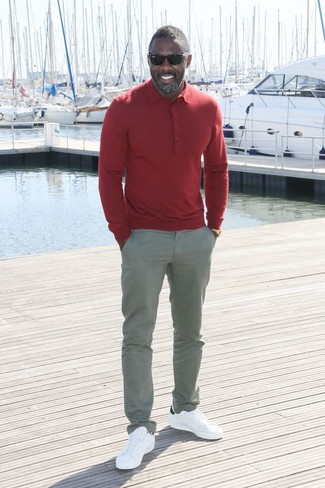 Idris Elba wearing Red Polo, Grey Chinos, White Leather Low Top Sneakers