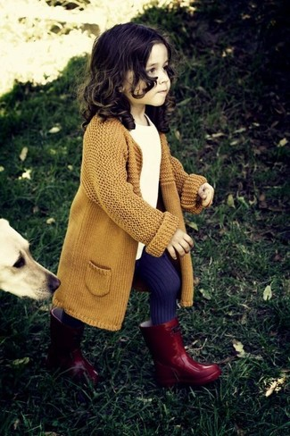 How to Wear Red Rain Boots For Girls: Reach for a mustard cardigan and a white t-shirt for your tot for a trendy and easy going look. Red rain boots are a good choice to complement this look.