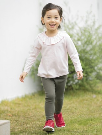 How to wear: red sneakers, dark green leggings, pink ruffle long sleeve t-shirt