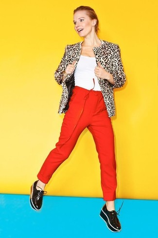 How to wear: black leather platform loafers, red tapered pants, white tank, beige leopard fur jacket