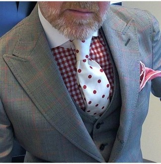 How to wear: red pocket square, red polka dot tie, red gingham dress shirt, grey check three piece suit