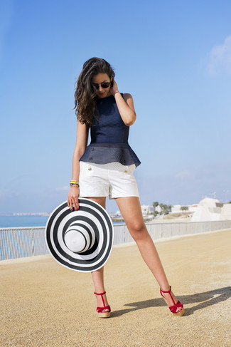 How to wear: white and black straw hat, red suede wedge sandals, white shorts, navy peplum top