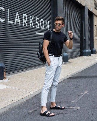 How to wear: black leather backpack, black leather sandals, white chinos, black crew-neck t-shirt