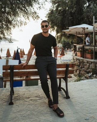How to wear: black sunglasses, black leather sandals, black chinos, black crew-neck t-shirt