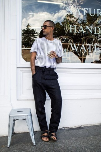 How to Wear a White and Black Horizontal Striped Crew-neck T-shirt For Men: If it's comfort and practicality that you love in menswear, wear a white and black horizontal striped crew-neck t-shirt with navy chinos. Rev up your whole outfit by rocking a pair of black leather sandals.