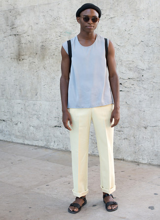 How to wear: black backpack, black leather sandals, yellow chinos, light blue tank